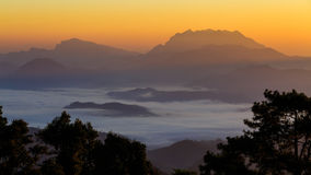 Mist with big mountain in the morning Royalty Free Stock Photography