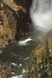 MIst at the bottom of Lower Falls, Yellowstone River, Wyoming. Stock Images
