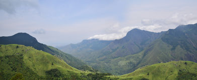 Mist-clad mountain. An enchanting view of the mountains from Top Station near Munnar, Kerala. The power and beauty of the Western Ghats comes to the fore in this Royalty Free Stock Photography