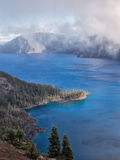 Mist and clouds at Crater Lake Stock Photo
