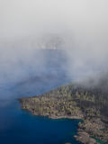 Mist and clouds at Crater Lake Stock Photography
