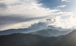 Mist and clouds in high mountain panorama Stock Image