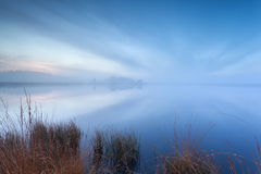 Mist and cloudscape on wild lake Royalty Free Stock Photography