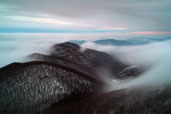 Mist and cloudy mountain at winter Royalty Free Stock Photos