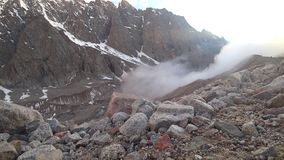 The mist is coming to the gorge. A lot of stones and rocks around. stock footage