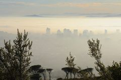 Mist covered city in the morning royalty free stock photography