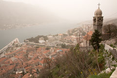 Mist Covered Kotor and St Mary's Church Stock Photography