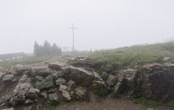 Mist covers the cross and fence Stock Photography