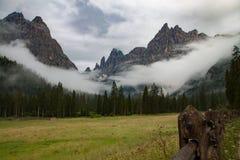 Mist in the dolomites, Fischleintal, Sexten, Pustertal, Bolzano, Trentino Alto Adige , Italy. Foggy day in the dolomites royalty free stock photo