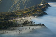 Mist envelops town and forest. Dramatic Java landscape, near Mount Bromo - an active volcano. Mist enveloping town Royalty Free Stock Images