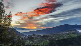 Mist flowing over Cemoro Lawang village in the morning located to northeast of Mt Bromo, Indonesia