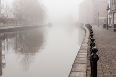 Mist Over the Canal in Wigan. The mist and the fog descend over the canal in Wigan near the Pier stock image