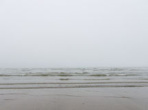 Mist and fog on the sea and the beach Stock Photo