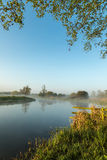 Mist hanging over river Nene in Northamptonshire at sunrise Stock Images