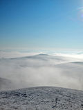 Mist in the hills. Above the mist - misty hills with blue sky Stock Photography