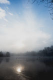 Mist hovering over a cold lake in Goldsworth Park, Surrey, Wokin Stock Photos