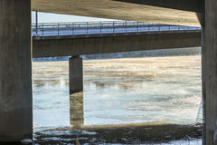 Mist on Icy River under Bridge Stock Photography