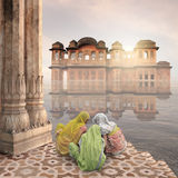 Mist in India. Palace in the midle of a lake in India Stock Images