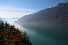 Mist on the lake. Colorful evening on the lake in swiss Alps stock images