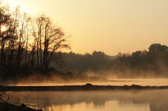 Mist on the lake at sunrise. Cross Creek Lake in Washington County Pennsylvania, during sunrise, a misty fog is seen on the water through the woods Royalty Free Stock Photos