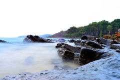Mist like water on beach rocks Royalty Free Stock Photography