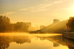 Mist morning Beijing Olympic Forest Park. Foggy and sunny morning, lakescape and Cruise terminal in sunrise