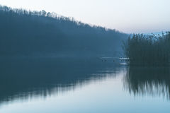 Mist of Morning lake Stock Photo