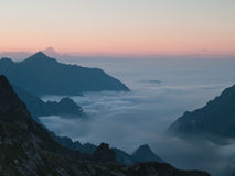 Mist among mountains. Evocative image of mist/fog among mountains at sunset Royalty Free Stock Photography