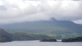 Mist and mountains of the Scottish Highlands, Scotland. Time lapse video footage looking over the misty peaks of the Scottish Highlands with a foreground loch stock video footage