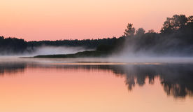 Mist Moves Through a Still Morning Stock Images