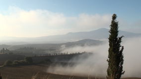 Mist moving. Over the Tuscan Val d'Orcia as the sun rises stock footage