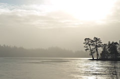 Mist over frozen lake, captured in Finland. Royalty Free Stock Photography