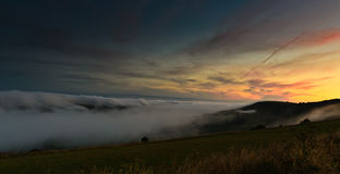 Mist over kimmeridge from steeple Stock Photos