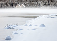 Mist over the lake of Antholz royalty free stock image