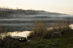 Mist over the lake. reeds and wooden jetty Stock Photo