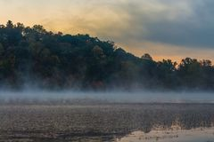 Lake with Mist in Morning with Colorful Clouds in Sky Royalty Free Stock Photo