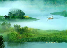 The mist over lucid lake (2). The morning mist over the Fuchun River in southern China Royalty Free Stock Image