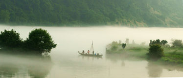 The mist over lucid lake. The morning mist over the Fuchun River in southern China stock photo