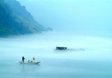 The mist over lucid lake. The morning mist over the Fuchun River in southern China royalty free stock image