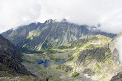 Mist over mountain peaks Stock Image