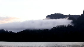 Mist over mountain and water stock footage
