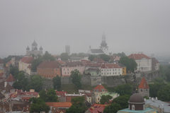 Mist over the old town of Tallinn, Estonia Stock Images