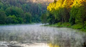 mist over the river in summer stock photo