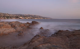Mist over rocks in Laguna Beach Stock Images