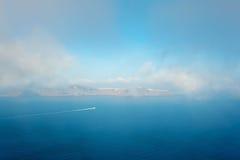 The mist over the Santorini caldera in Greece Stock Photo