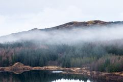 Loch Mudle. Mist over the woodland at Loch Mudle, Ardnamurchan in Lochaber, Scotland. 25 December 2017 Royalty Free Stock Image