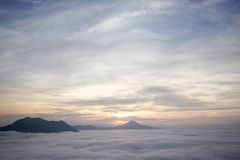 Mist Phu Tok at Chiang Khan. Go to the top of Phu Thok Seeing the beauty of the sea. Since the sun is not up to me. The golden light faintly With these words Royalty Free Stock Photo