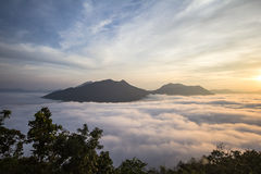 Mist Phu Tok at Chiang Khan. Go to the top of Phu Thok Seeing the beauty of the sea. Since the sun is not up to me. The golden light faintly With these words Royalty Free Stock Photos