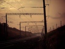 Mist railroad. Summer twilight cloudy sky electrified railway Royalty Free Stock Photography
