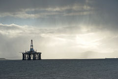 Mist and rain. Over the Cromarty Firm with a drilling rig sheltering Royalty Free Stock Images